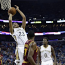 New Orleans Pelicans power forward Anthony Davis (23) shoots over Cleveland Cavaliers power forward Tristan Thompson (13) and shooting guard Matthew Dellavedova (9) in the first half of an NBA basketball game in New Orleans, Friday, Nov. 22, 2013 The Asso
