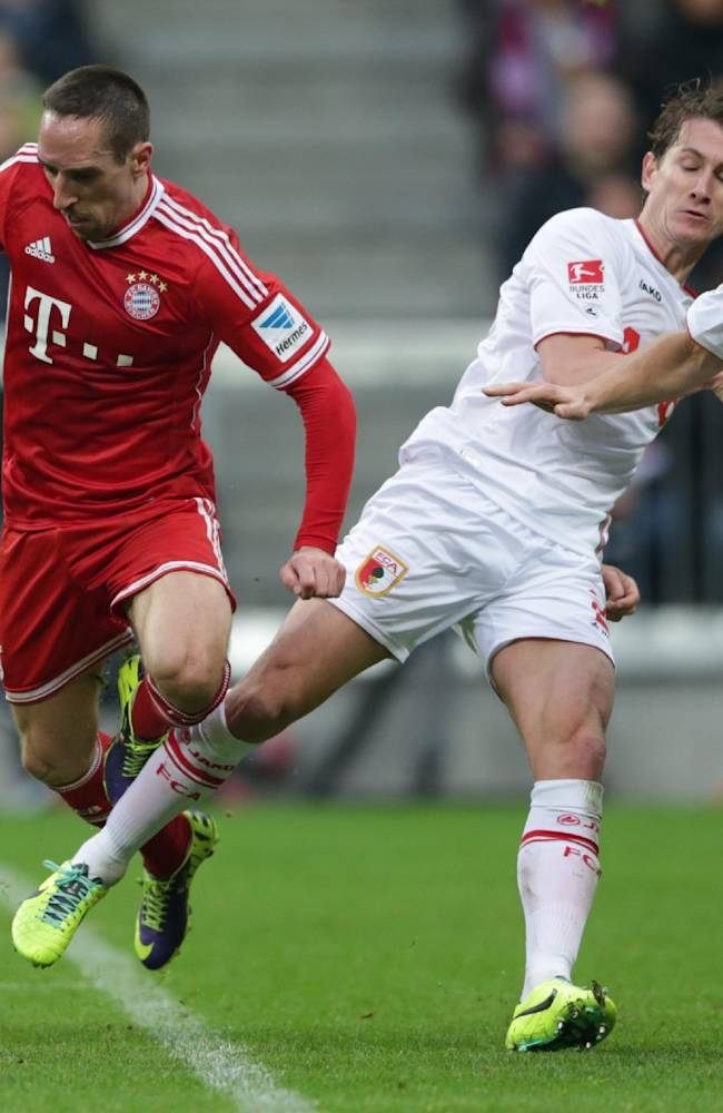 Augsburg's Paul Verhaegh of the Netherlands, 2nd right, fouls Bayern's Franck Ribery of France during the German first division Bundesliga soccer match between FC Bayern Munich and FC Augsburg, in Munich, southern Germany, Saturday, Nov. 9 2013