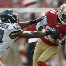 San Francisco 49ers wide receiver Brandon Lloyd (84) catches a pass in front of Philadelphia Eagles cornerback Bradley Fletcher (24) during the first quarter of an NFL football game in Santa Clara, Calif., Sunday, Sept. 28, 2014. The Associated Press