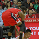 Houston Rockets guard Jeremy Lin, bottom, and Washington Wizards guard John Wall go after a loose ball during the first half of an NBA basketball game in Houston, Wednesday, Feb. 12, 2014 The Associated Press