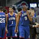 Philadelphia 76ers guard James Anderson (9) wipes his face in the closing minutes of their 103-95 loss to the Atlanta Hawks in an NBA basketball game Monday, March 31, 2014, in Atlanta The Associated Press