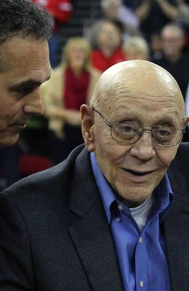 In this March 1, 2014 file photo, Jerry Tarkanian is escorted by his son, Danny, during halftime ceremonies honoring their former coach at Fresno State University in Fresno, Calif. Hall of Famer Jerry Tarkanian has been admitted to a Las Vegas hospital after relatives say he was feeling weak and having trouble breathing.  Tarkanian's son, Danny, says his 83-year-old father was also struggling to keep his eyes open when he was taken to Valley Hospital on Wednesday night, April 9, 2014. The elder Tarkanian remained sedated at the hospital Thursday morning