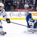 Toronto Maple Leafs goalie James Reimer (34) stops Los Angeles Kings forward Anze Kopitar (11) during a shootout in NHL hockey game action in Toronto, Sunday, Dec. 14, 2014 The Associated Press