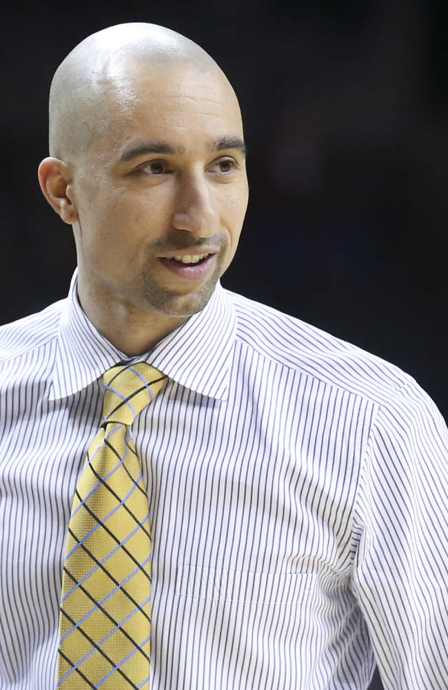 VCU head coach Shaka Smart smiles during the second half of an NCAA college basketball game against Richmond in the quarterfinal round of the Atlantic 10 Conference tournament at the Barclays Center in New York, Friday, March 14, 2014. VCU defeated Richmond, 71-53