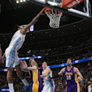 Denver Nuggets forward Wilson Chandler, left, dunks the ball for a basket over Los Angeles Lakers forward Ryan Kelly, second from left, as Nuggets center Timofey Mozgov, third from left, of Russia, and Lakers center Pau Gasol, of Spain, look on in the fou