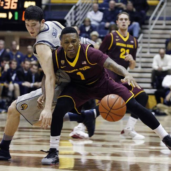 Arizona State's Jahii Carson, right, dribbles toward the basket as California's Sam Singer defends during the second half of an NCAA college basketball game, Wednesday, Jan. 29, 2014 in Berkeley, Calif