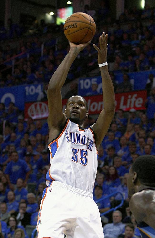 Oklahoma City Thunder forward Kevin Durant (35) shoots against the Memphis Grizzlies during the fourth quarter of Game 1 of the opening-round NBA basketball playoff series in Oklahoma City on Saturday, April 19, 2014. Oklahoma City won 100-86