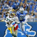 Detroit Lions wide receiver Calvin Johnson (81), defended by Green Bay Packers cornerback Sam Shields (37) makes a catch during the first half of an NFL football game in Detroit, Sunday, Sept. 21, 2014 The Associated Press