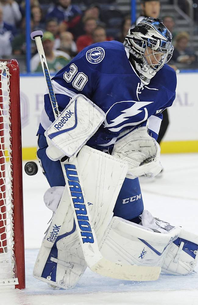 Tampa Bay Lightning goalie Ben Bishop makes a save on a shot by the Minnesota Wild during the first period of an NHL hockey game Thursday, Oct. 17, 2013, in Tampa, Fla