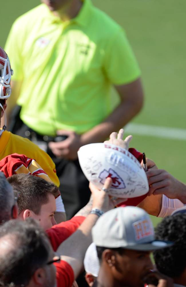Kansas City Chiefs quarterbacks Tyler Bray, left, and Alex Smith sign autographs after a NFL training camp practice on the Missouri Western State University campus, Thursday, July 24, 2014 in St. Joseph, Mo