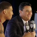 Arizona head coach Sean Miller, right, laughs as he speaks next to forward Brandon Ashley during NCAA college basketball Pac-12 media day in San Francisco, Thursday, Oct. 23, 2014. (AP Photo/Jeff Chiu)