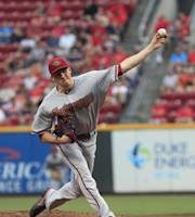 Arizona Diamondbacks Patrick Corbin pitches against the Cincinnati Reds in the first inning of a baseball game in Cincinnati on Tuesday, Aug. 20, 2013. (AP Photo/Tom Uhlman)