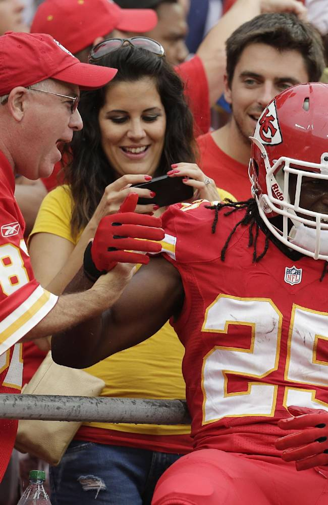 Kansas City Chiefs running back Jamaal Charles (25) celebrates a touchdown with fans during the first half of an NFL football game against the Dallas Cowboys at Arrowhead Stadium in Kansas City, Mo., Sunday, Sept. 15, 2013