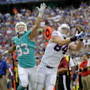 Buffalo Bills tight end Scott Chandler (84) makes a catch in front of Miami Dolphins outside linebacker Jason Trusnik (93) during the first half of an NFL football game on Sunday, Sept. 14, 2014, in Orchard Park, N.Y The Associated Press
