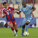 Bayern's Mario Goetze, left, and Manchester City's Fernandinho challenge for the ball during the Champions League group E soccer match between Bayern Munich and Manchester City in Munich, Germany, Wednesday Sept.17,2014