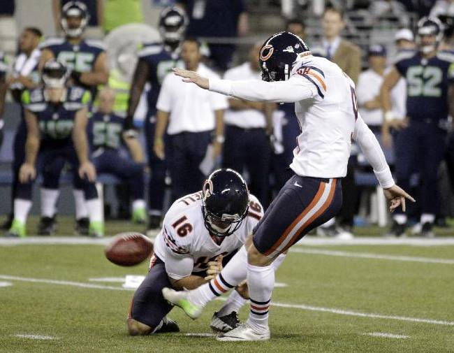 Chicago Bears' Robbie Gould kicks his second field goal of the night against the Seattle Seahawks, as Pat O'Donnell holds in the second half of a preseason NFL football game, Friday, Aug. 22, 2014, in Seattle. The Seahawks won 34-6
