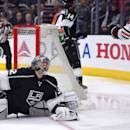Los Angeles Kings goalie Jonathan Quick, left, reacts after being scored on by Chicago Blackhawks right wing Patrick Kane during the first period of an NHL hockey game, Wednesday, Jan. 28, 2015, in Los Angeles. (AP Photo/Mark J. Terrill)