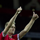 Manchester United's Darren Fletcher gestures, after scoring against Valencia, during a pre season friendly soccer match at Old Trafford Stadium, Manchester, England, Tuesday Aug. 12, 2014