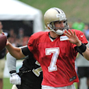 New Orleans Saints quarterback Luke McCown (7) prepares to pass during NFL football training camp in White Sulphur Springs, W.Va., Sunday, July 27, 2014 The Associated Press