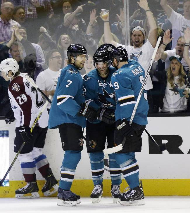 San Jose Sharks' Patrick Marleau, center, celebrates his goal with teammates Brad Stuart (7), and Martin Havlat (9), of the Czech Republic, during the first period of an NHL hockey game against the Colorado Avalanche on Friday, April 11, 2014, in San Jose, Calif