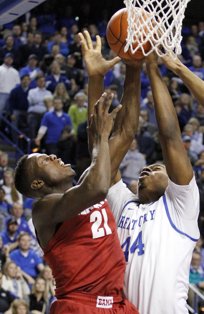 Kentucky's Dakari Johnson (44) and Alabama's Rodney Cooper (21) go after a rebound during the second half of an NCAA college basketball game, Tuesday, March 4, 2014, in Lexington, Ky. Kentucky won 55-48