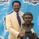 FILE - In this Saturday, Aug. 4, 2007 file photo, former Detroit Lions tight end Charlie Sanders stands with his bronze bust during the Pro Football Hall of Fame Induction Ceremony at the Pro Football Hall of Fame in Canton, Ohio. Sanders played 10 seasons in the NFL. The Detroit Lions say Hall of Fame tight end Charlie Sanders has died at age 68, Thursday, July 2, 2015. (AP Photo/Phil Long, File)