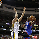 Philadelphia 76ers' Thaddeus Young (21) goes up to shoot against Utah Jazz's Enes Kanter (0) during the first half of an NBA basketball game on Saturday, March 8, 2014, in Philadelphia The Associated Press