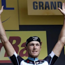 Omega Pharma-Quick Step team rider Matteo Trentin of Italy celebrates on the podium after winning the 234.5 km seventh stage of the Tour de France cycling race from Epernay to Nancy July 11, 2014.                  REUTERS/Jean-Paul Pelissier