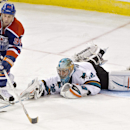San Jose Sharks goalie Alex Stalock (32) makes the poke-check on Edmonton Oilers' Ryan Smyth (94) during third period NHL hockey action in Edmonton, Alberta Friday Nov. 15, 2013 The Associated Press