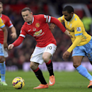 Manchester United's Wayne Rooney, left, and Crystal Palace's Jason Puncheon battle for the ball during their English Premier League match at Old Trafford, Manchester England Saturday Nov. 8, 2014