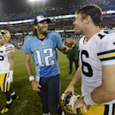 Tennessee Titans quarterback Charlie Whitehurst (12) talks with Green Bay Packers quarterback Scott Tolzien (16) after the Titans defeated the Packers 20-16 in a preseason NFL football game Saturday, Aug. 9, 2014, in Nashville, Tenn The Associated Press