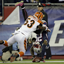 New England Patriots cornerback Kyle Arrington (25) tumbles into the end zone with a touchdown after recovering a fumble, as Cincinnati Bengals linebacker Marquis Flowers (53) defends in the second half of an NFL football game Sunday, Oct. 5, 2014, in Fox