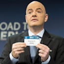 UEFA General Secretary Gianni Infantino, shows a ticket with British soccer team Arsenal FC during the draw of the round of 16 of the UEFA Champions League 2014/15 in Nyon, Switzerland, Monday, Dec. 15, 2014