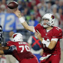 Arizona Cardinals quarterback Ryan Lindley (14) throws against the Seattle Seahawks during the first half of an NFL football game, Sunday, Dec. 21, 2014, in Glendale, Ariz. (AP Photo/Rick Scuteri)