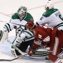 Dallas Stars' Kari Lehtonen, left, Finland, makes a save on a shot by Arizona Coyotes' Joe Vitale (14) as Stars' Trevor Daley (6) defends during the third period of an NHL hockey game Tuesday, Nov. 11, 2014, in Glendale, Ariz. The Stars defeated the Coyot
