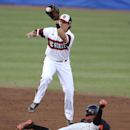 Miami's Ricky Eusebio steals second before North Carolina State's Logan Ratledge can make the tag in the third inning in the Atlantic Coast Conference NCAA college baseball tournament game in Durham, N.C., Friday, May 22, 2015. (Ethan Hyman/The News & Record via AP)