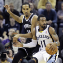 Memphis Grizzlies' Mike Conley (11) moves the ball in front of Brooklyn Nets' Shaun Livingston in the first half of an NBA basketball game in Memphis, Tenn., Saturday, Nov. 30, 2013 The Associated Press