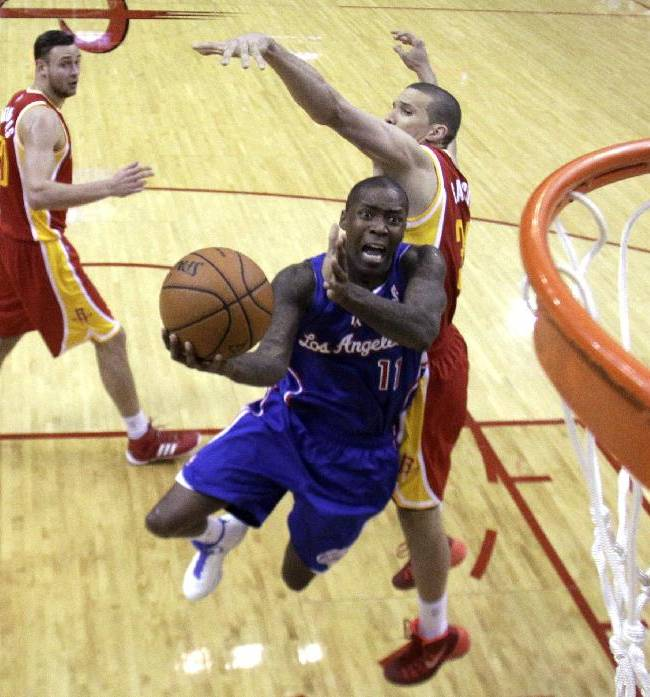 Los Angeles Clippers guard Jamal Crawford (11) drives past Houston Rockets guard Francisco Garcia, right, during the fourth quarter of an NBA basketball game, Saturday, March 29, 2013, in Houston. The Clippers defeated the Rockets 118-107