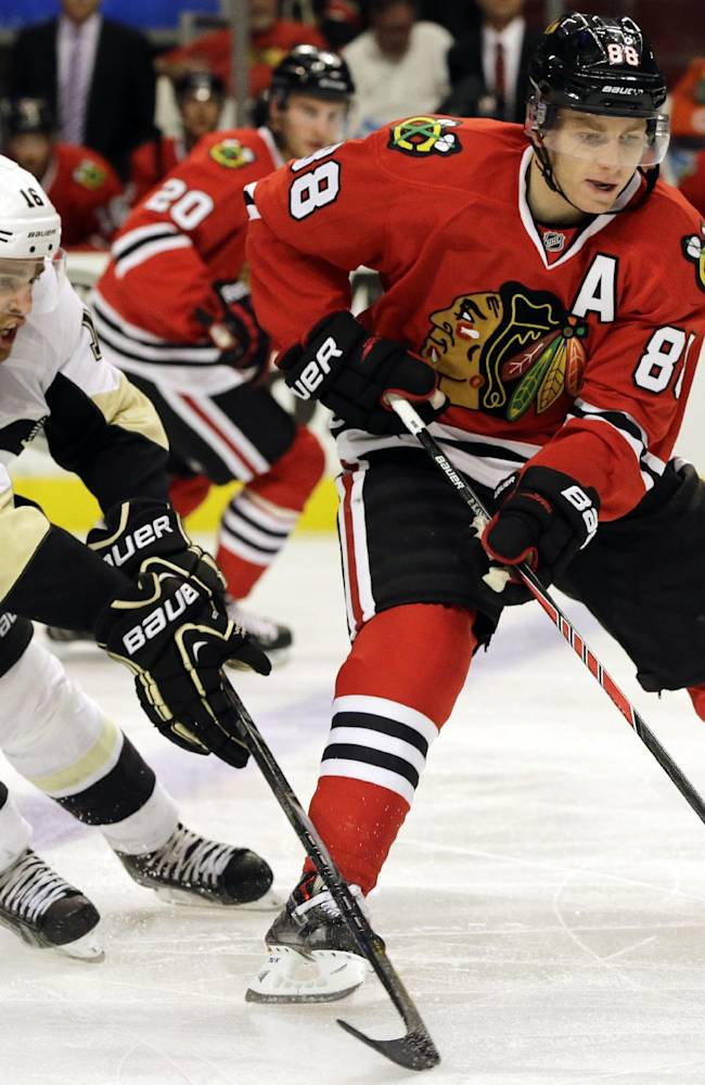 Chicago Blackhawks' Patrick Kane, right, controls the puck against Pittsburgh Penguins' Brandon Sutter during the second period of an NHL preseason hockey game in Chicago, Thursday, Sept. 19, 2013