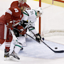 Dallas Stars' Antoine Roussel (21) is unable to get a shot off in front of the goal as Phoenix Coyotes' Mike Ribeiro (63) defends the play during the first period of an NHL hockey game on Sunday, April 13, 2014, in Glendale, Ariz The Associated Press