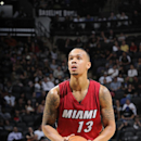 SAN ANTONIO - OCTOBER 18: Shabazz Napier #13 of the Miami Heat attempts a free throw against the San Antonio Spurs at the AT&T Center on October 18, 2014 in San Antonio, Texas