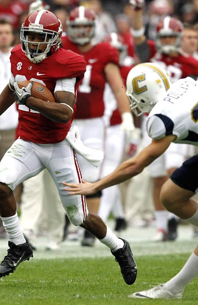 Alabama wide receiver Christion Jones (22) gets past Chattanooga kicker Nick Pollard (30) and returns a punt for a touchdown during the first half of an NCAA college football game on Saturday, Nov. 23, 2012, in Tuscaloosa, Ala