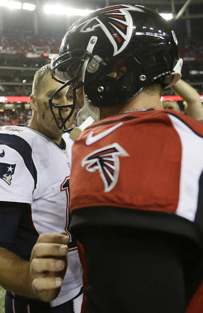 New England Patriots quarterback Tom Brady (12) speaks with Atlanta Falcons quarterback Matt Ryan (2) after the second half of an NFL football game, Sunday, Sept. 29, 2013, in Atlanta. The Patriots won 30-23