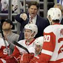 Detroit Red Wings head coach Mike Babcock talks to his team during the first period of an NHL hockey game against the Chicago Blackhawks in Chicago, Sunday, March 16, 2014. (AP Photo/Nam Y. Huh)