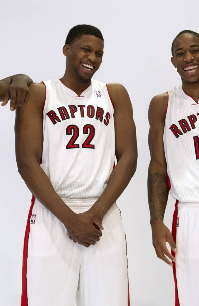 Toronto Raptors' Terrence Ross (31), Rudy Gay (22) and DeMar DeRozan (10) joke around as they pose at the teams NBA basketball media day in Toronto, Monday Sept. 30, 2013 in Toronto