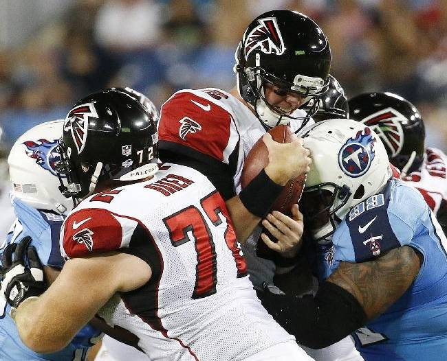 Atlanta Falcons quarterback Matt Ryan (2) is hit by Tennessee Titans defensive tackle Jurrell Casey (99) as Atlanta Falcons tackle Sam Baker (72) blocks during the first half of an NFL preseason football game, Saturday, Aug. 24, 2013, in Nashville, Tenn