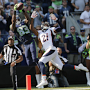 Seattle Seahawks wide receiver Ricardo Lockette (83) catches a pass for a touchdown over Denver Broncos cornerback Aqib Talib during the first half of an NFL football game, Sunday, Sept. 21, 2014, in Seattle The Associated Press