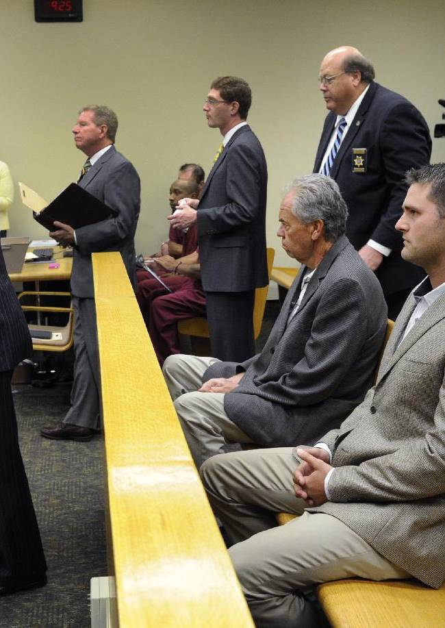Former New York Jets quarterback Erik Ainge, second from right in front row, listens as his defense attorney, Marcos Garza, left, speaks during a court hearing Friday, July 18, 2014, in Knoxville, Tenn. Ainge had all charges against him from a DUI arrest from last summer dropped. The 28-year-old Ainge was arrested by Knoxville police on Interstate 40 in July 2013 and was charged with driving under the influence, violating the implied consent law and a roadway lane violation. All charges were dismissed Friday during Ainge's scheduled appearance at Knox County General Sessions Court. The police officer who made the arrest had moved out of state and was unavailable to testify