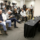 Chicago Bulls guard Derrick Rose, right, listens to a question about his injured knee during an NBA basketball news conference at the United Center Thursday, Dec. 5, 2013, in Chicago The Associated Press