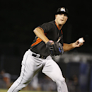 Miami Marlins relief pitcher Dan Jennings throws to first on New York Yankees' Ichiro Suzuki's fifth-ining groundout in a spring exhibition baseball game in Tampa, Fla., Friday, March 28, 2014. The Yankees won 3-0 The Associated Press